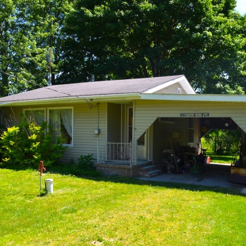 Single family home with attached carport located at Bear Lake