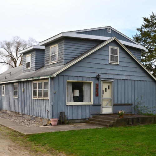 3 bedroom home w/ an oversized 2-car detached garage, (3) outbuildings and empty lots on Bear Lake