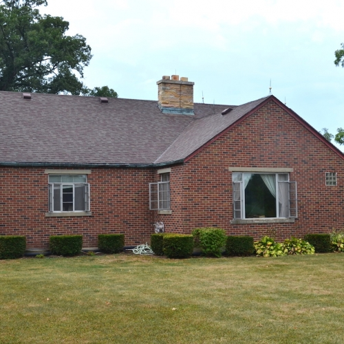 Single family home on basement w/ attached 2-car garage & barn sitting on 1.10+/- acre lot.