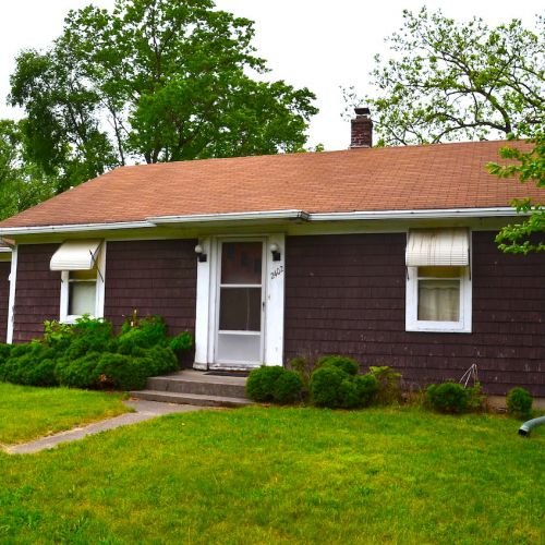 Investment 3 bedroom home with garage on a large corner lot